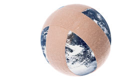 Plastered Earth Macro Isolated. Isolated macro image a plastered planet earth Stock Image