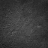 Plastered fragment of the wall, painted in dark gray color Royalty Free Stock Images