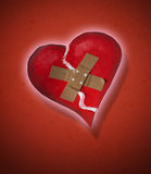 Plastered heart. A broken heart that has been plastered Royalty Free Stock Photo