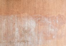 Plastered, Painted And Faded Peachy Wall Background Royalty Free Stock Photography