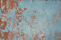 Plastered verkratzte Wand mit Schalenfarbe Stockbild