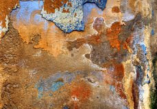 Plastered wall. Detail from plastered wall in decay, showing coloured patterns. you can see all kinds of images in the wall. The phenomenon to see images in royalty free stock image