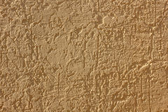 Plastered wall with a flesh-colored furrows abstract texture Stock Photos