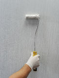 Plastered wall painted with a brush Stock Photo