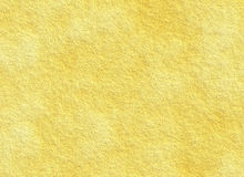 Plastered yellow texture of a dry wall Royalty Free Stock Photo