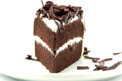 Plasterek bogaty czekoladowy tort Zdjęcia Royalty Free