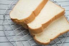 Plasterek chleb na tle Zdjęcia Stock