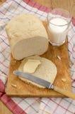 Plasterek chleb z masłem Obrazy Stock