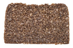 Plasterek Czarny chleb na bielu Obrazy Stock