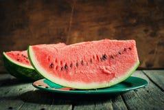 Plasterek melon na talerzu Zdjęcia Stock