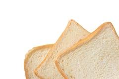 Plasterek odizolowywający na bielu biały chleb Zdjęcia Stock