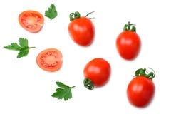 plasterek pomidor z pietruszką odizolowywającą na białym tle Odgórny widok zdjęcie royalty free