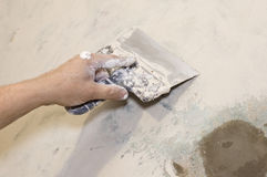 Plasterer. Putty joints with surfacer Royalty Free Stock Photography