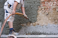Plasterer. Plastered an old exterior wall Royalty Free Stock Photos