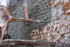 Plasterer. Plastered an old exterior wall Royalty Free Stock Image