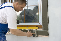 Plasterer. Inflicts mortar on architectural element Stock Photography