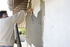 Plasterer. Inflicts mortar on wall Royalty Free Stock Photo