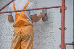 Plasterer applying a finish coating to a wall 2 Royalty Free Stock Images