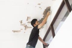 Plasterer at ceiling renovation decoration Stock Photo