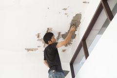 Plasterer at ceiling renovation decoration Royalty Free Stock Images