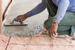 Plasterer concrete cement floor Stock Photo