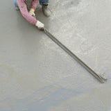 Plasterer concrete cement worker plastering flooring Royalty Free Stock Photo