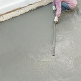 Plasterer concrete cement worker plastering flooring Royalty Free Stock Photography