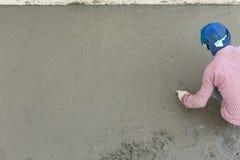 Plasterer concrete cement worker plastering flooring Stock Image