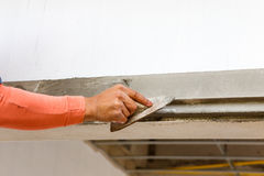 Plasterer concrete on wall of house construction stock photo
