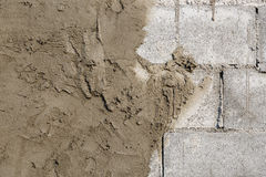 Plasterer concrete on wall of house construction Stock Image