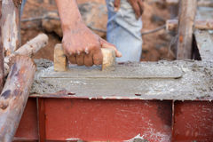 Plasterer concrete worker at beam being constructed Royalty Free Stock Photography