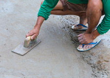 Plasterer concrete worker at floor of house construction Royalty Free Stock Photography