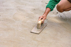 Plasterer concrete worker at floor of house construction Stock Images
