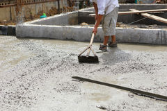A plasterer concrete worker at floor work Royalty Free Stock Photo