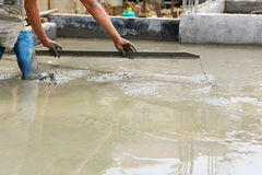 A plasterer concrete worker at floor work Royalty Free Stock Photography
