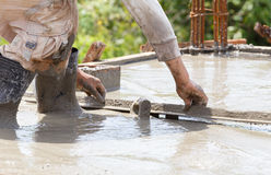 Plasterer concrete worker at floor work Stock Images