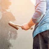 Plasterer concrete worker at wall of home Royalty Free Stock Photo