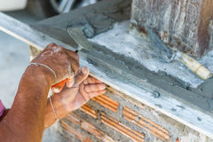 Plasterer concrete worker at wall of house construction Stock Photos
