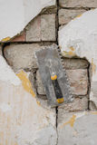 Plasterer. Concrete worker at wall of house construction Stock Photo