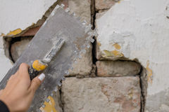 Plasterer. Concrete worker at wall of house construction Stock Photos