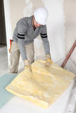 Plasterer doing repairs in house Stock Images