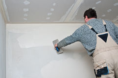 Plasterer or dry waller at work stock image