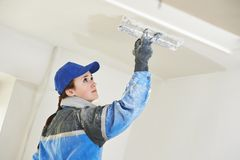 Plasterer at indoor ceiling work Royalty Free Stock Photo