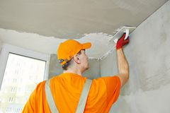 Plasterer at indoor ceiling work Stock Image