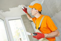 Plasterer at indoor ceiling work royalty free stock images