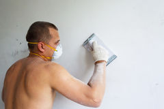 Plasterer at indoor renovation Stock Photos