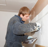 Plasterer at indoor renovation decoration with putty knife Royalty Free Stock Photography