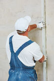 Plasterer at indoor wall renovation Royalty Free Stock Image