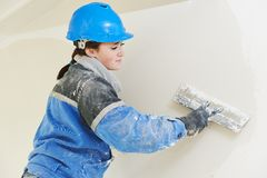 Plasterer at indoor wall work Stock Images