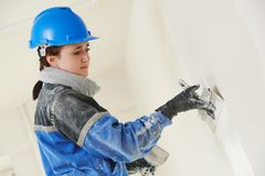 Plasterer at indoor wall work Royalty Free Stock Images